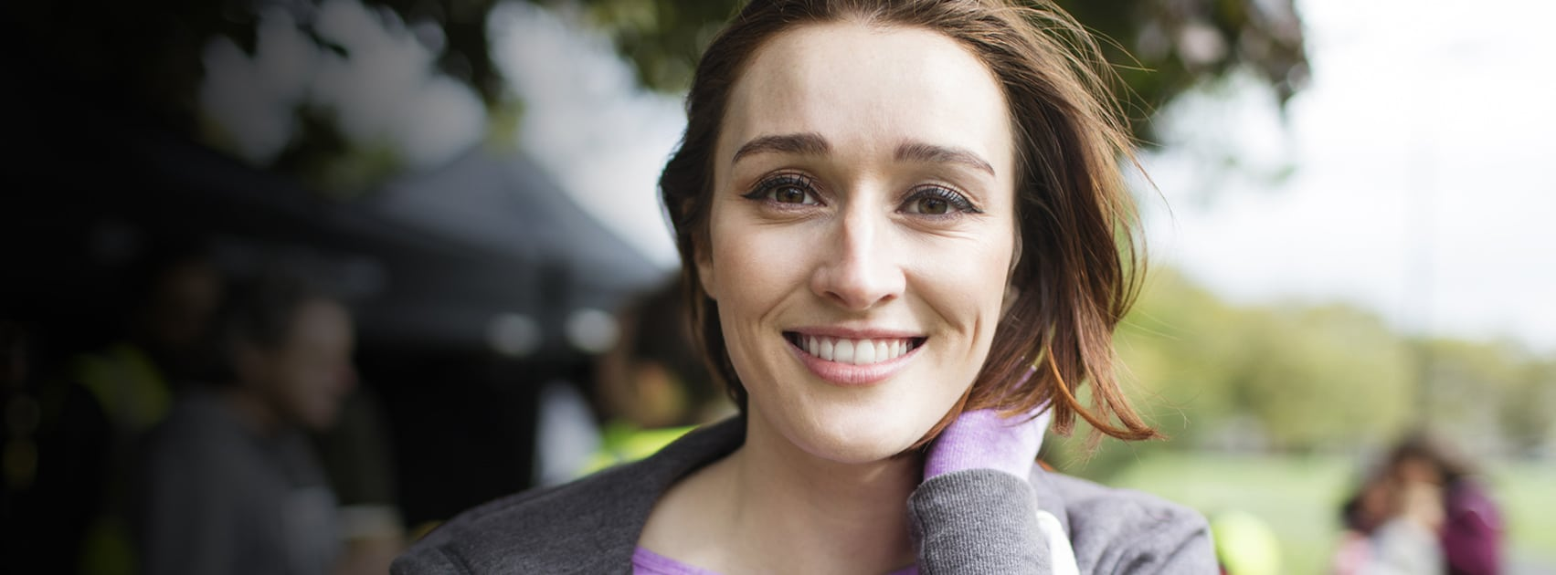 Banner image of a younger woman smiling