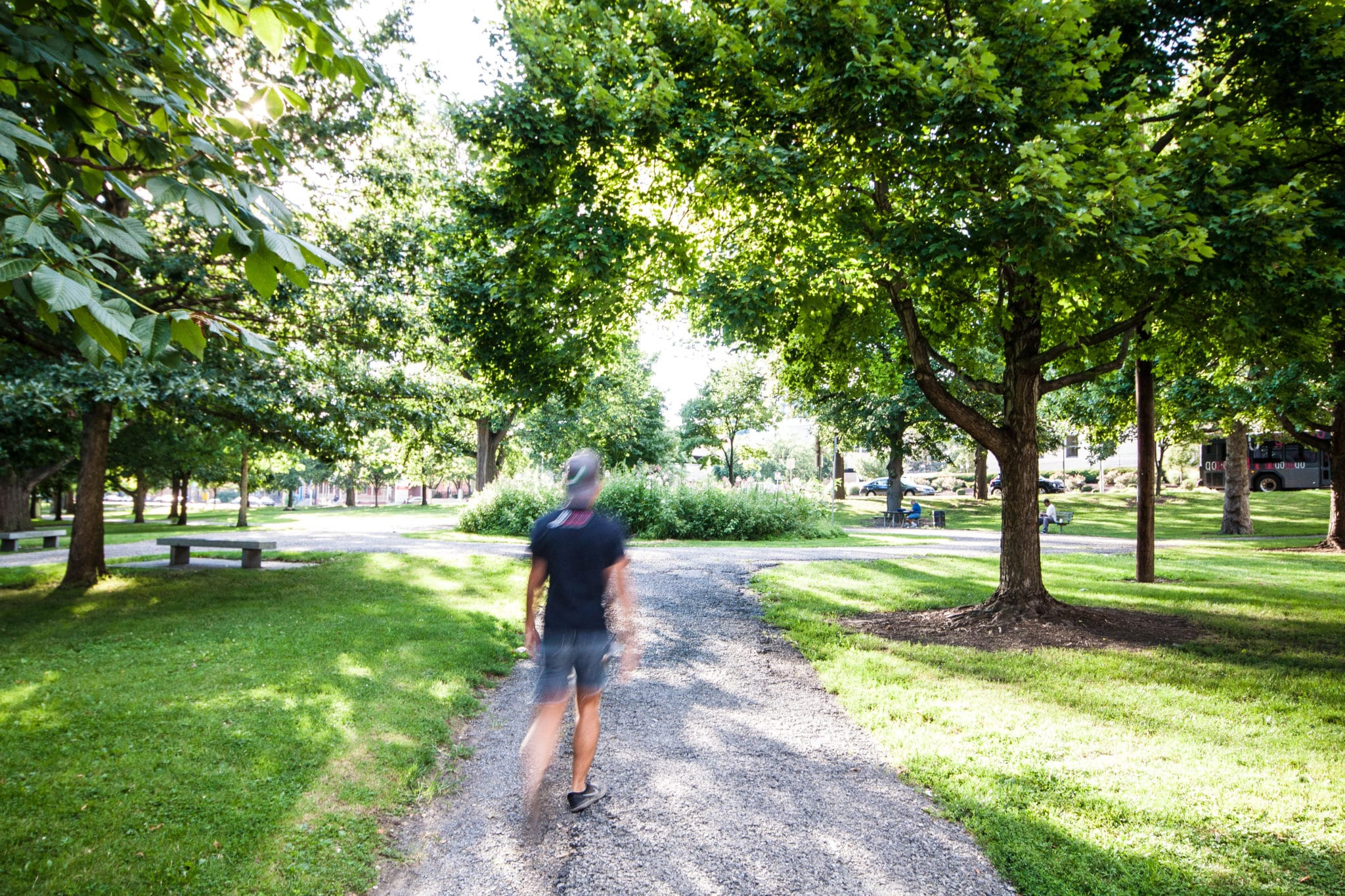 A man walking through Allegheny Commons Park