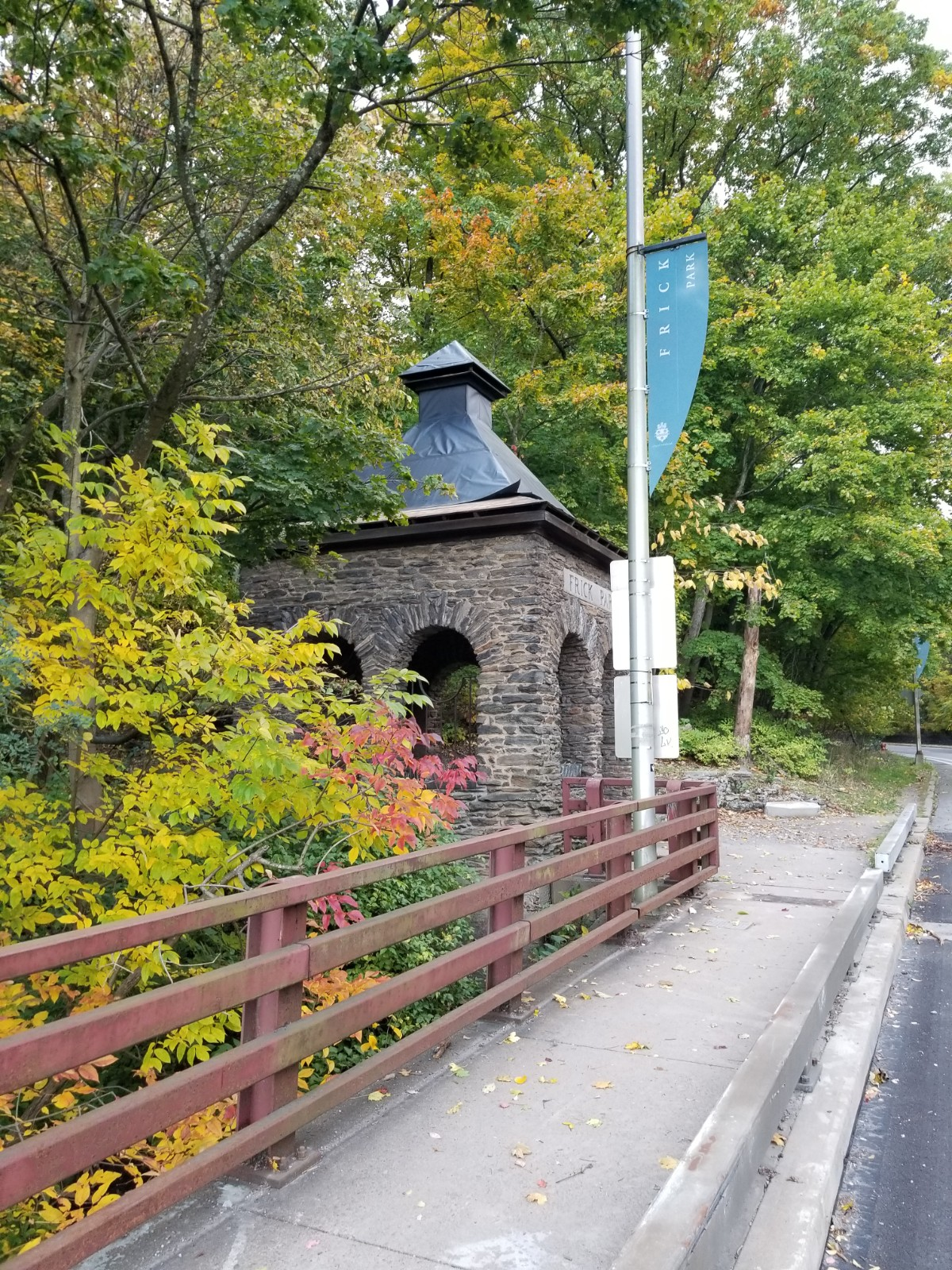 Forbes Avenue Gatehouse at Frick Park surrounded by trees
