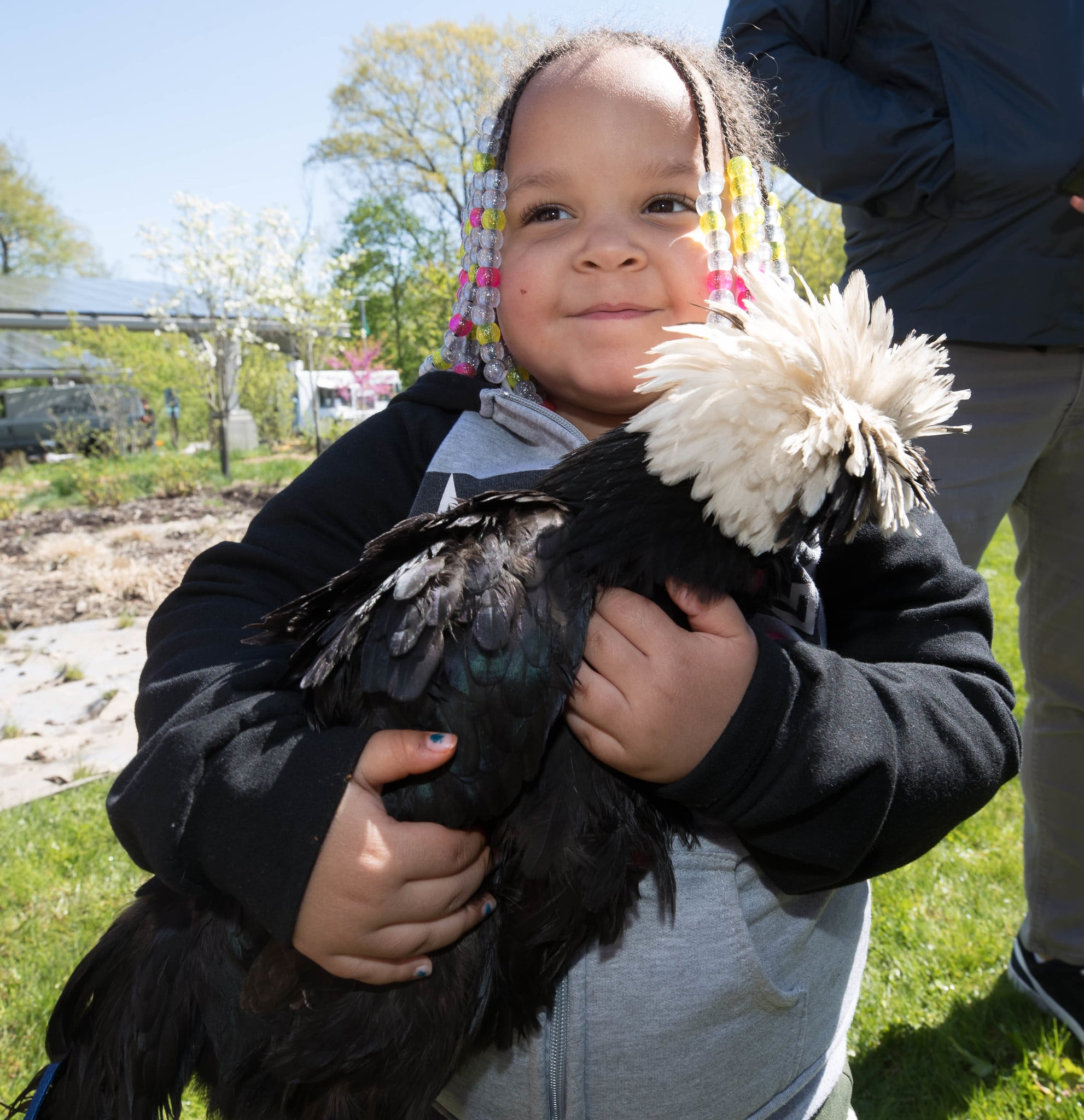 Young girl holding a large bird at Frick Park
