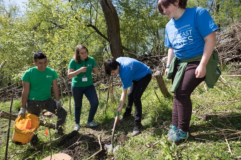 PPC staff and volunteers working together in a park