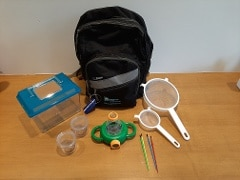 Image containing outdoor exploration supplies with a backpack