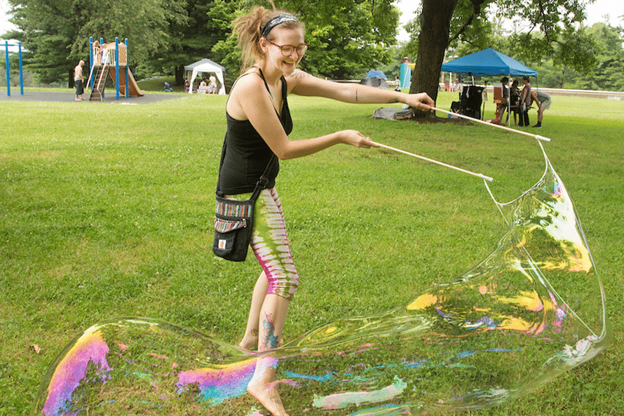 Person blowing bubbles
