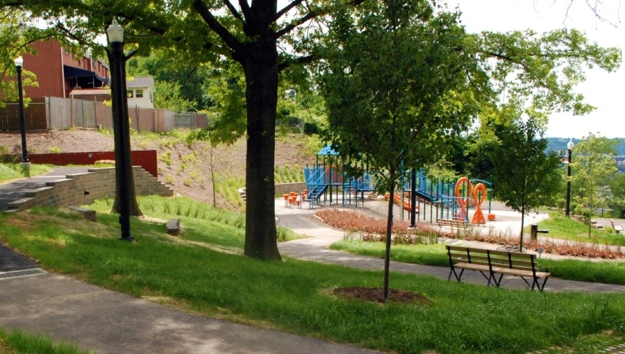 August Wilson Park playground among greenery and trees