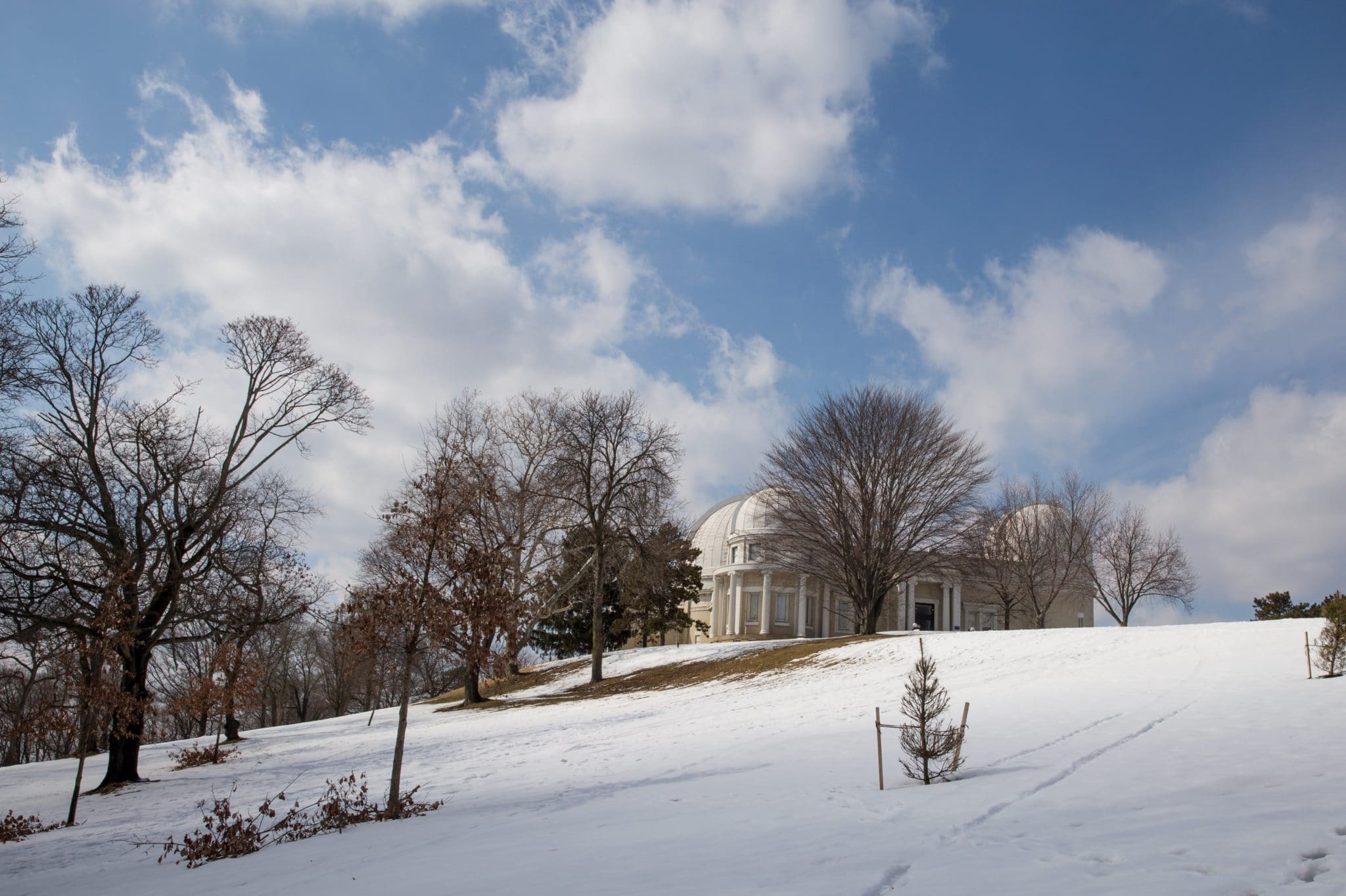 Allegheny Observatory in winter with snow in field