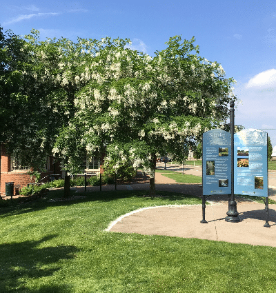 Schenley Park visitor center sign among trees