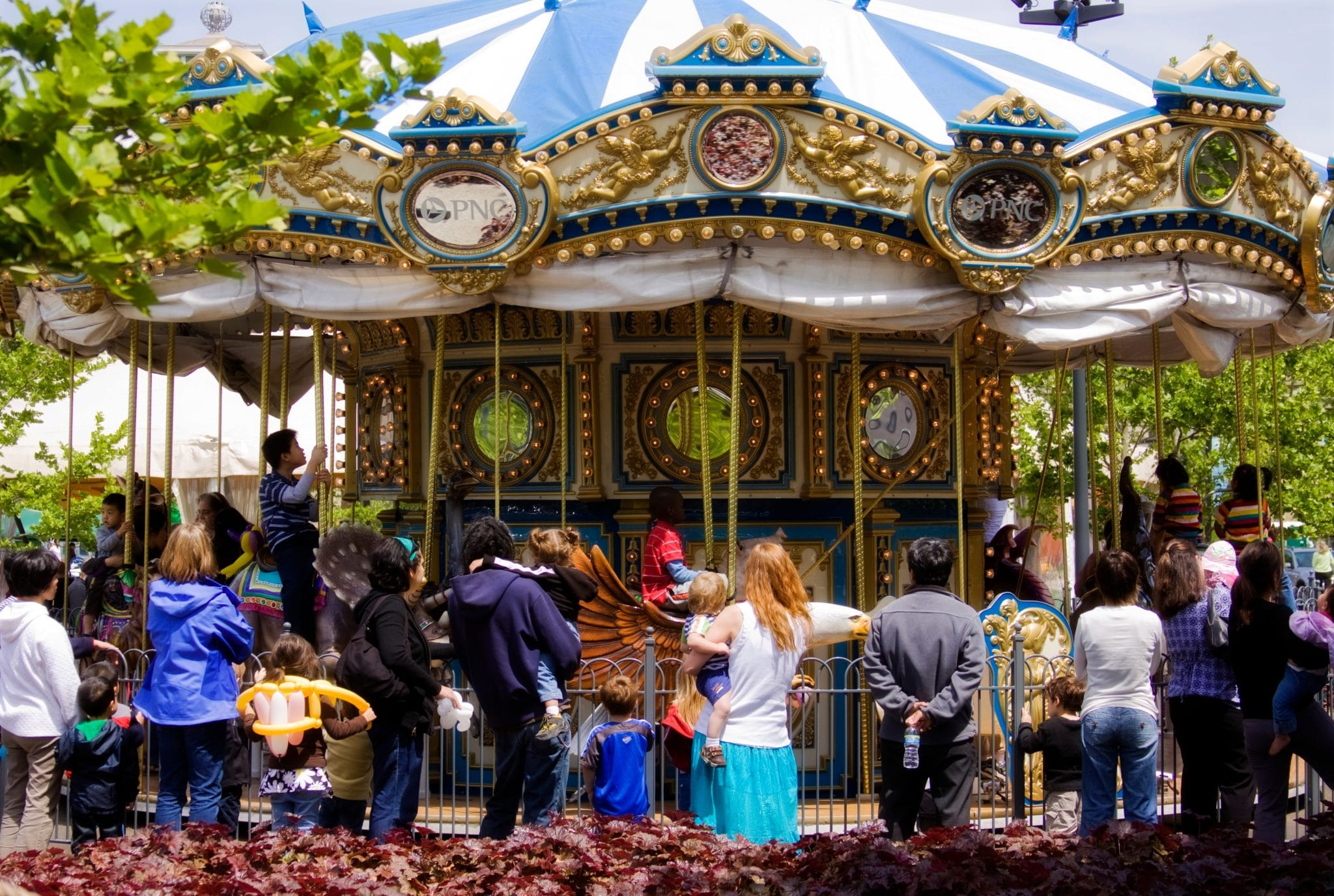 People are waiting for the carousel at Schenley Plaza