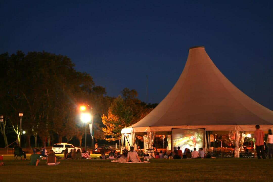 Schenley Park tent with people watching a movie