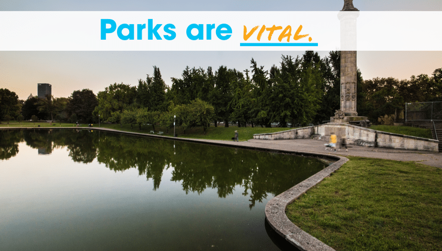 """An image of Allegheny Commons Lake Elizabeth including a tall statue at sunset, with the words """"Parks are Vital"""" written at the top."""