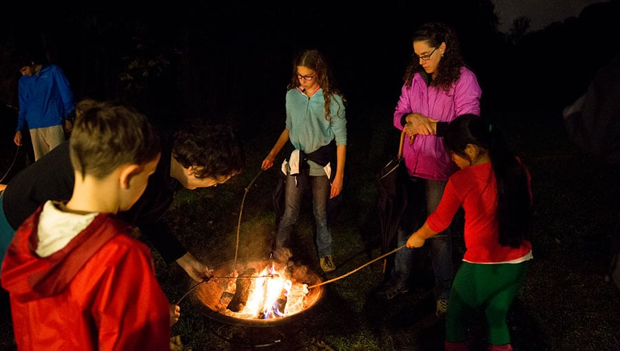 An image of children roasting marshmallows.
