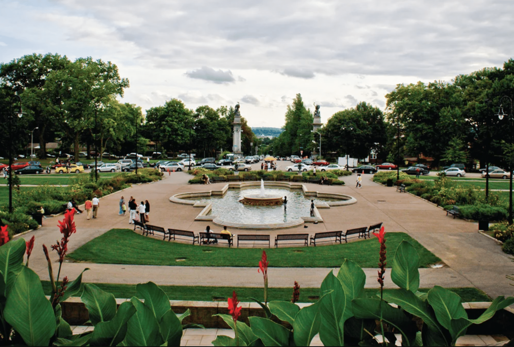 Image featuring Highland Park fountain on an overcast day with flowers in bloom