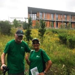 Volunteer naturalists posing in front of the FEC