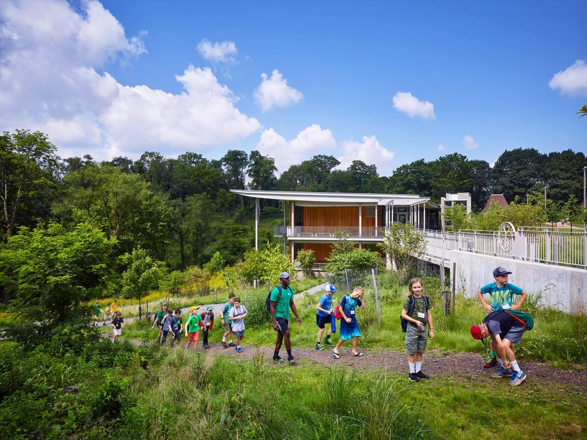 A group of young people walking outside the Frick Environmental Center