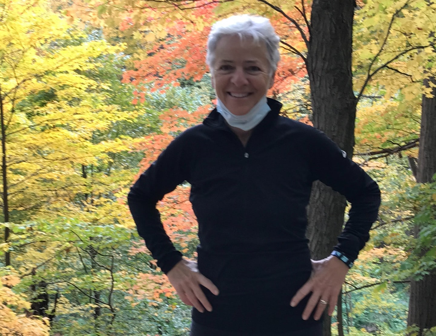 A woman standing near a tree in Frick Park.
