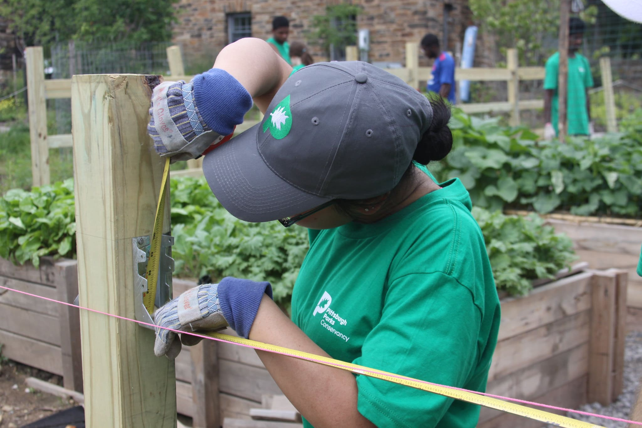 Person measuring garden walls