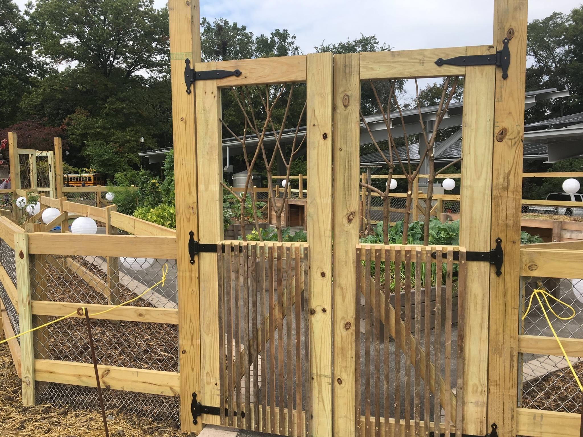 A wooden gate to the From Slavery to Freedom garden