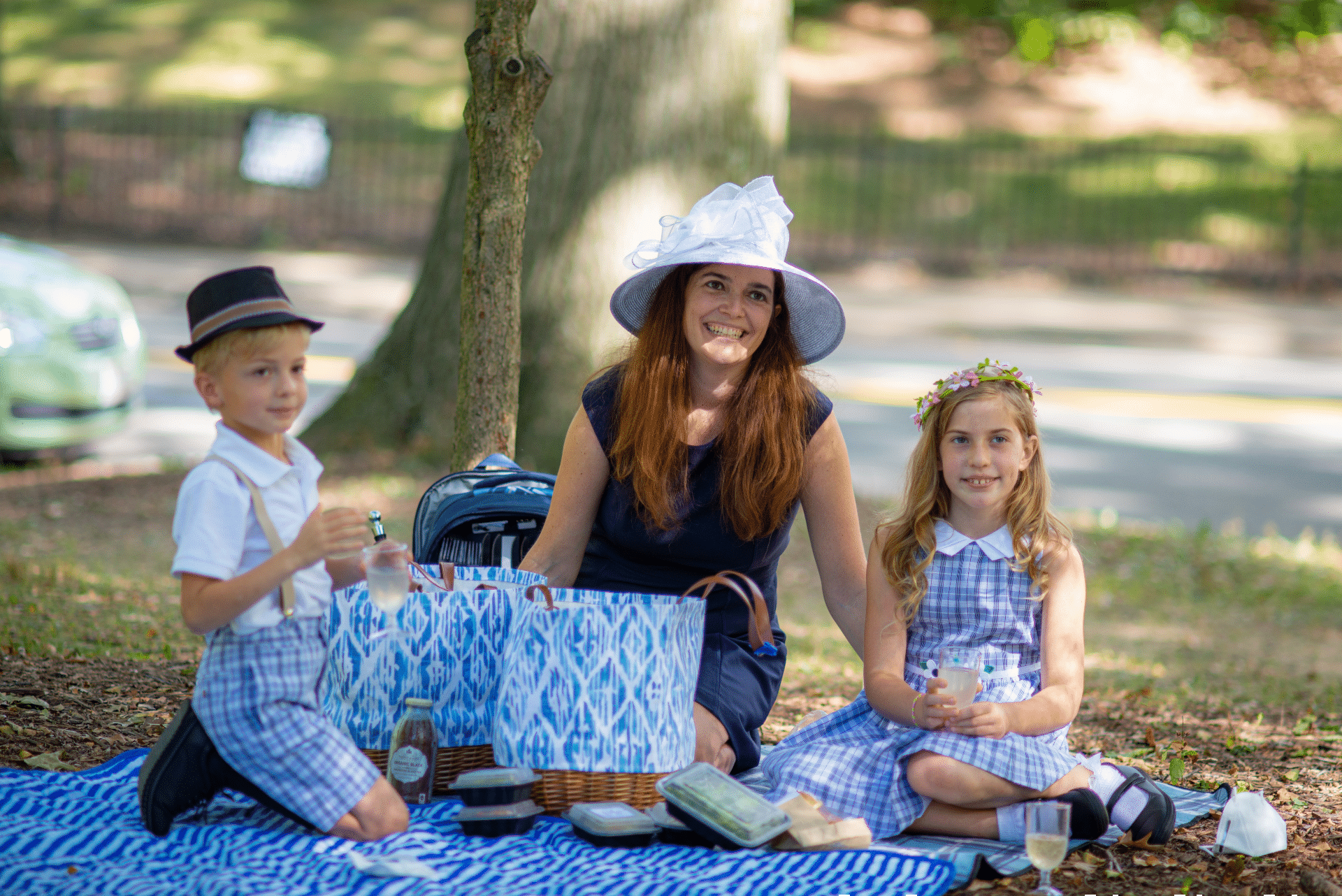 A mother and her two children at the Picnic In Your Park Event
