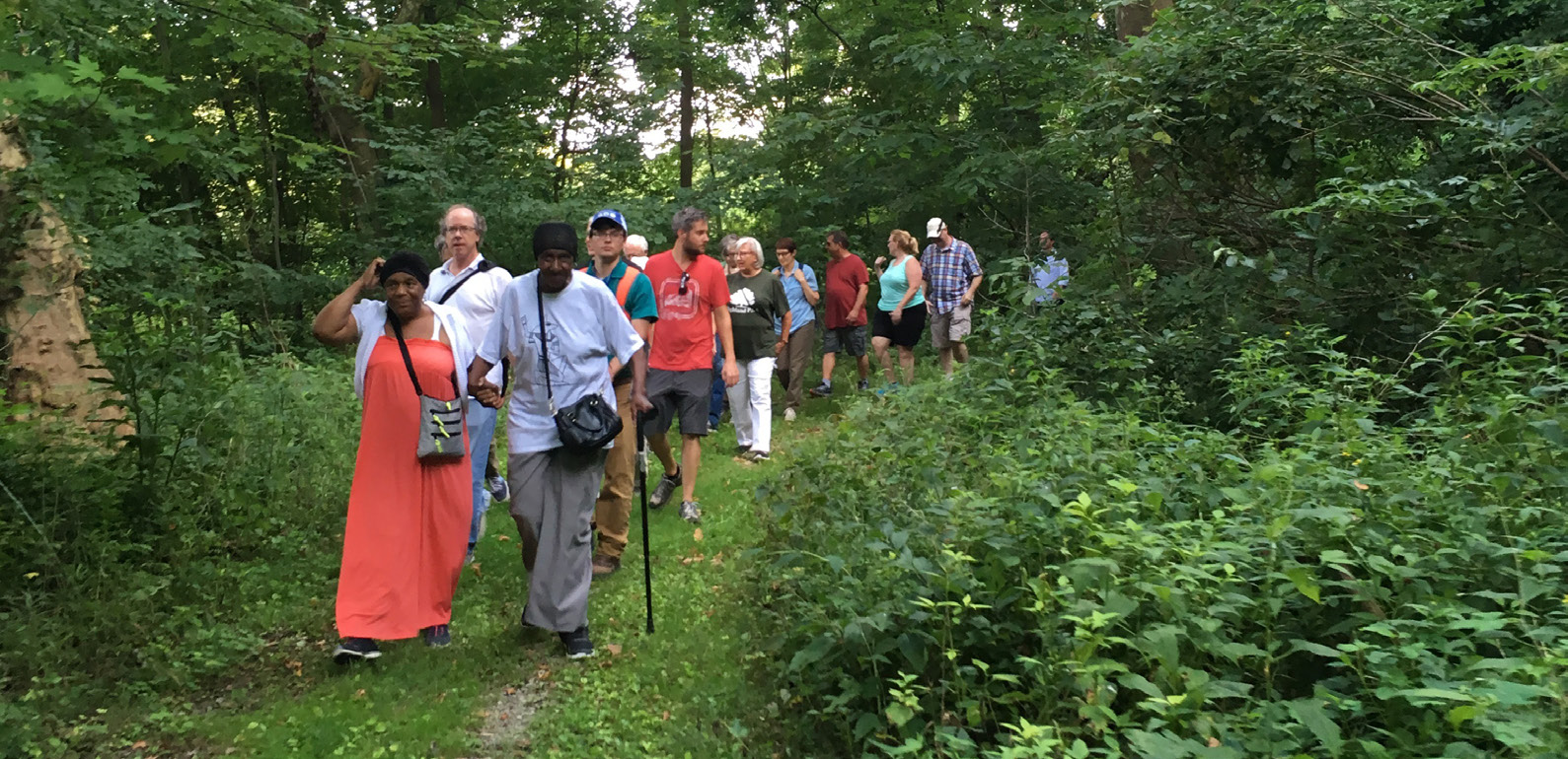 A group of people on a watershed task force tour.