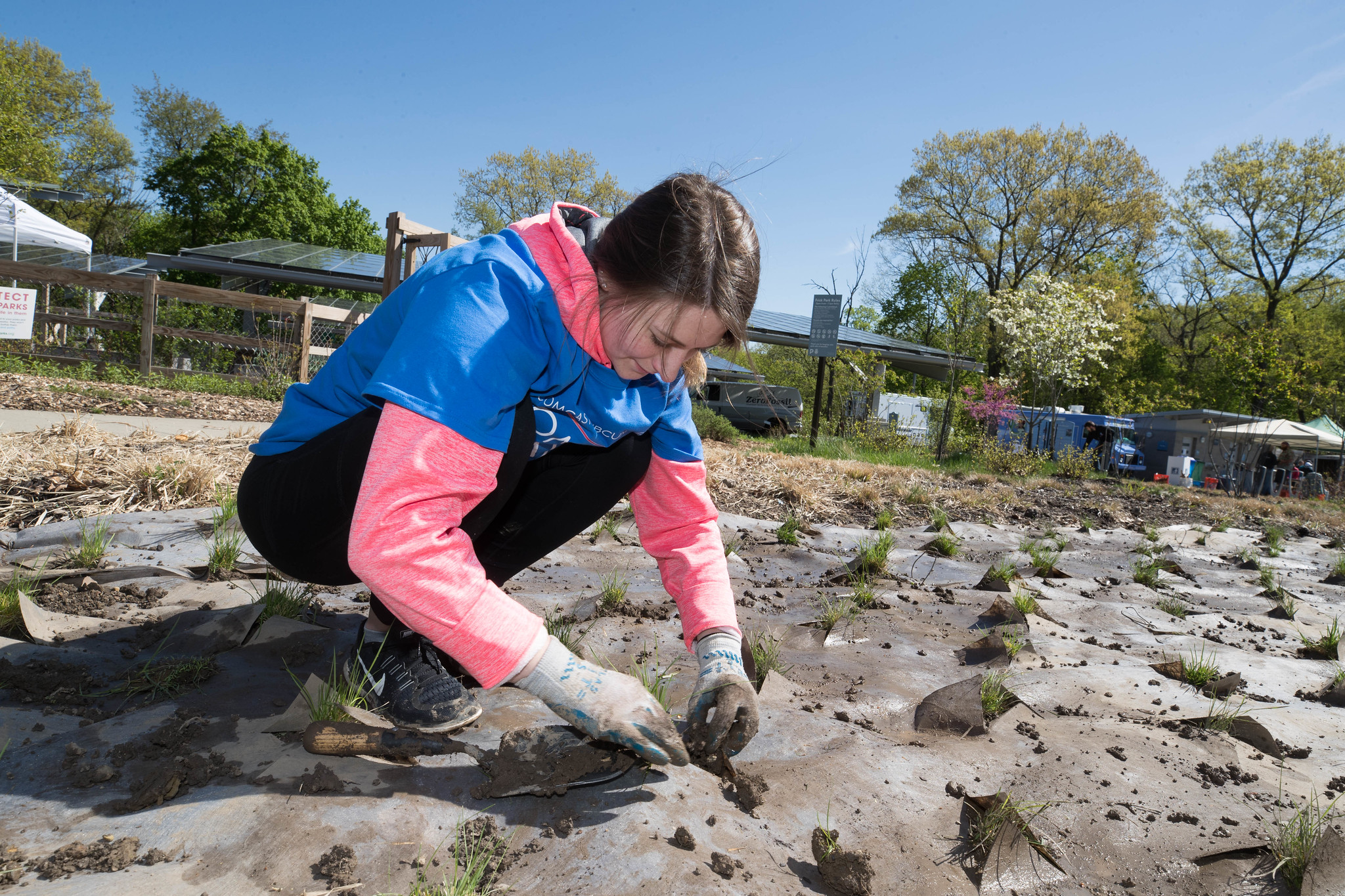 Young person planting in mud