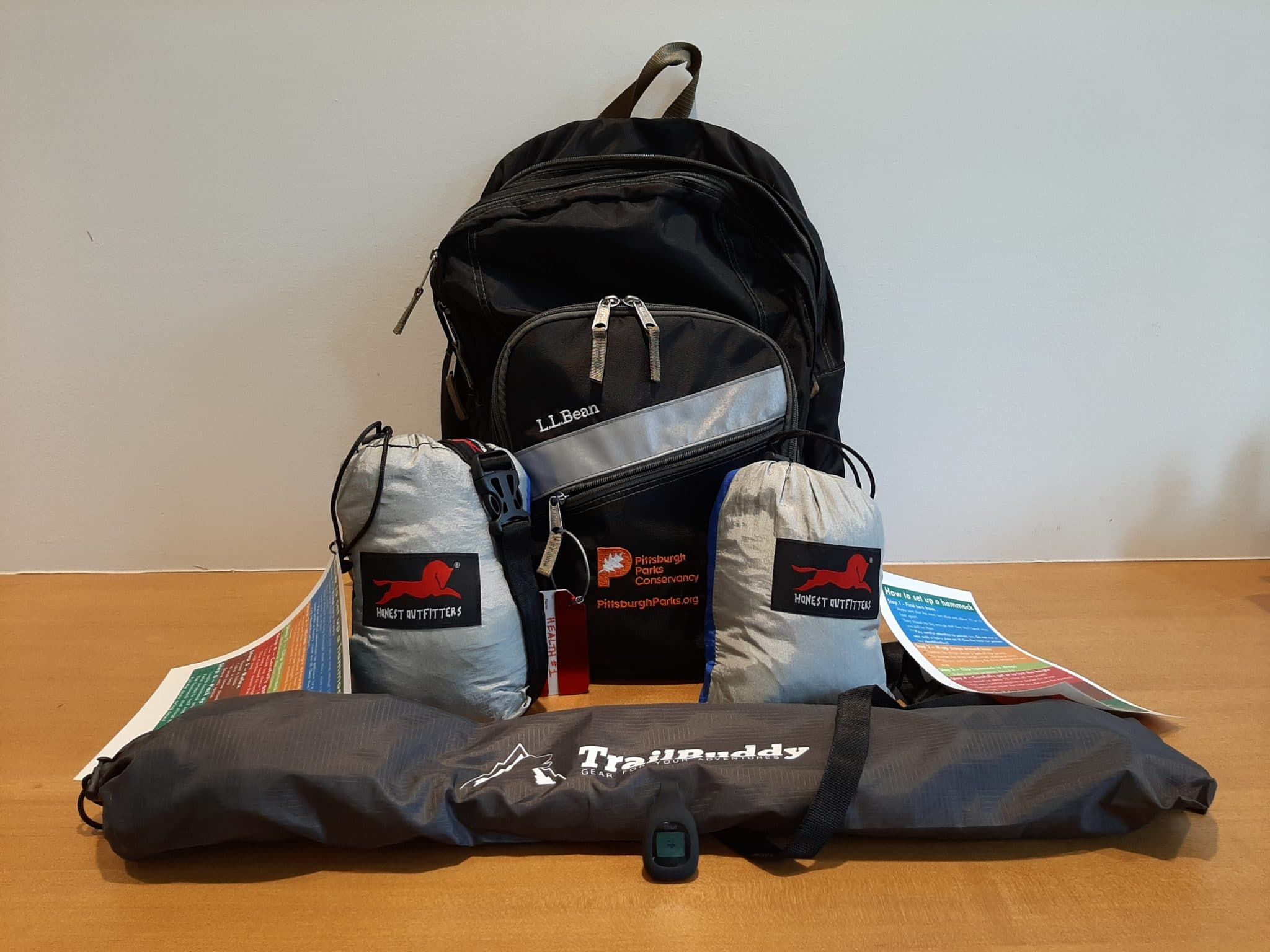 A backpack with materials and guides