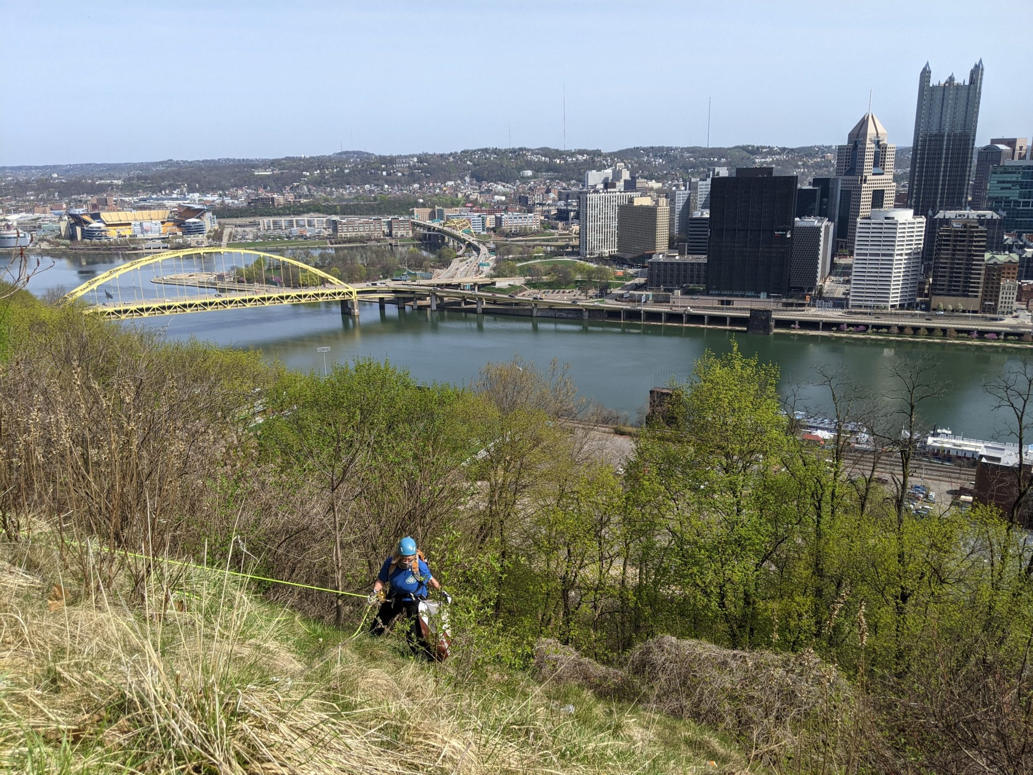 Emerald View Park with person scaling and cleaning up hill