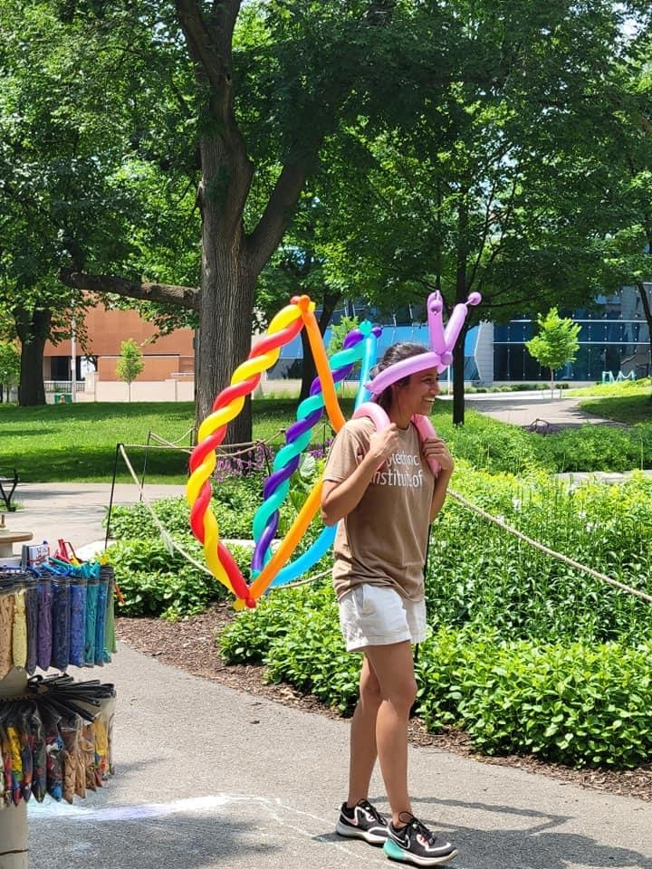 Person carrying balloon art