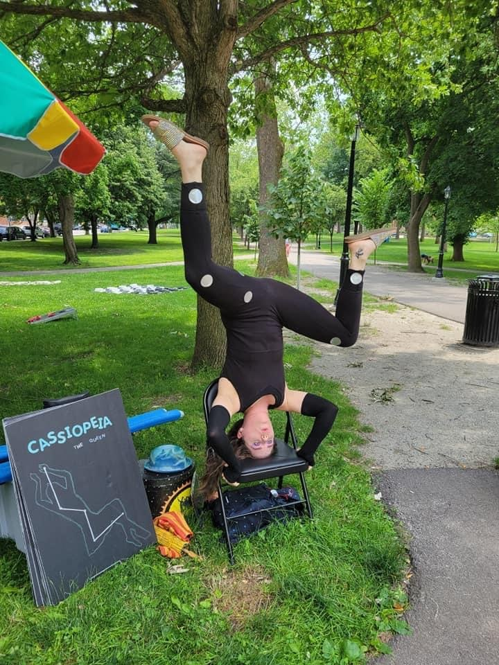 Person doing a handstand on a chair
