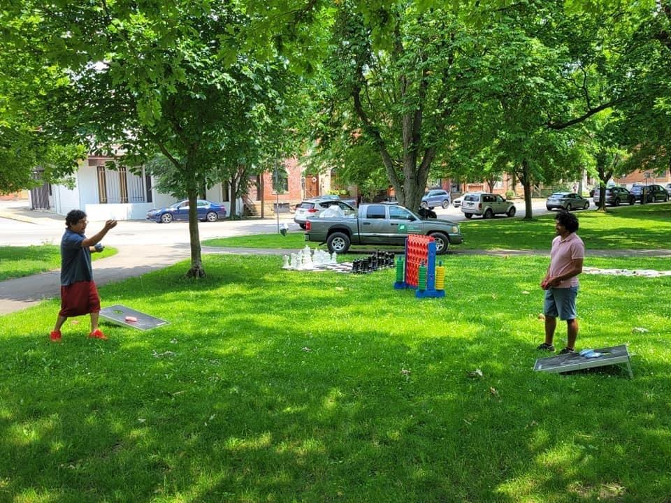 Adults playing cornhole
