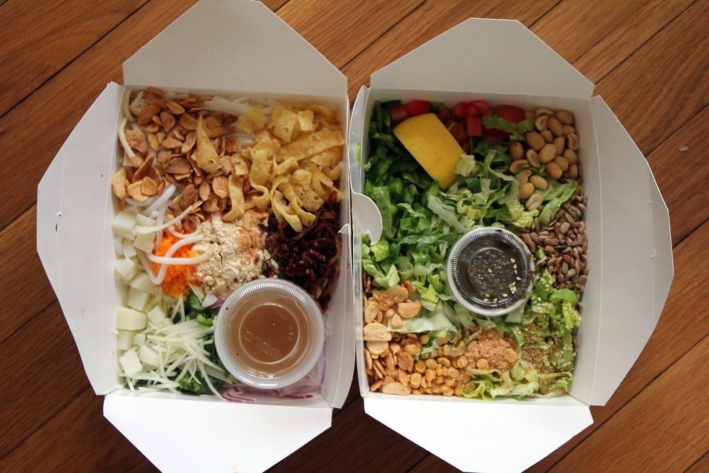 Two salad lunches in takeout boxes