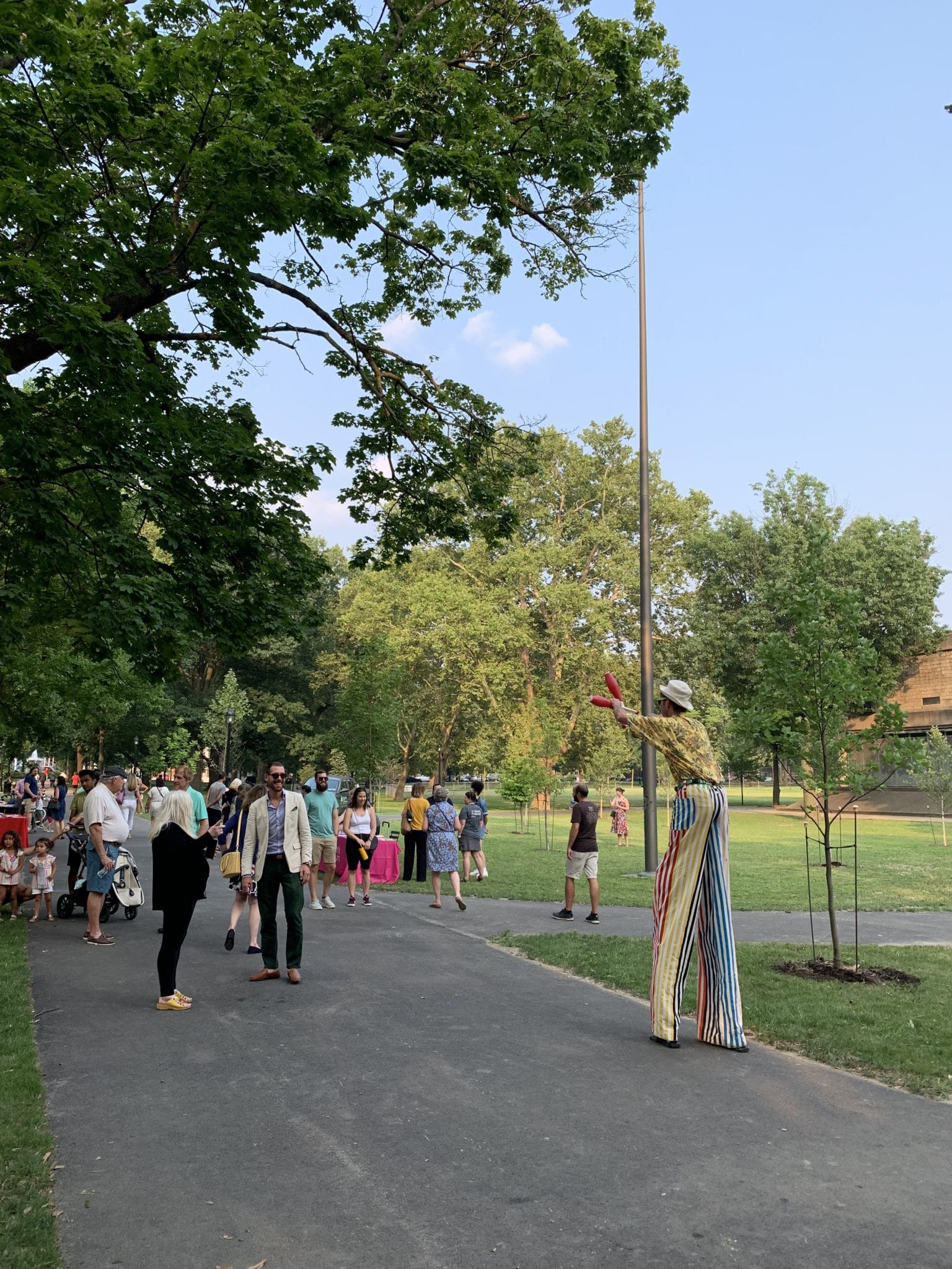 People enjoying a celebration in Allegheny Commons Park.