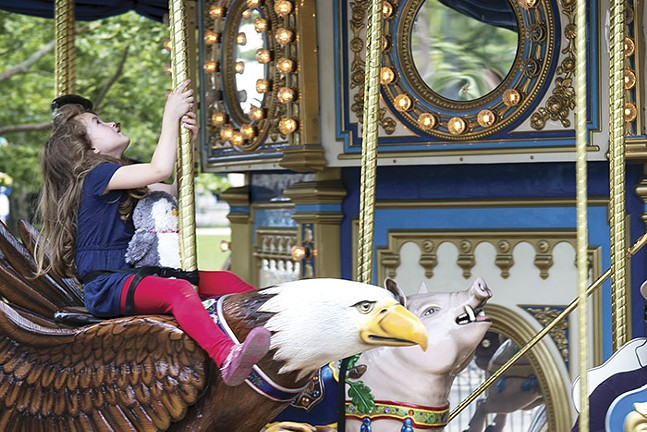 Child riding a carousel